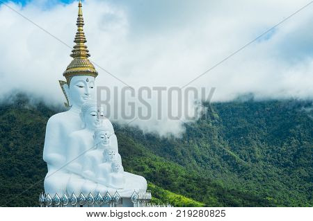 Phetchabun Province Thailand - September 3 2017: Five White Buddha statues sitting at Wat Pha Sorn Kaew Temple or Wat Phra Thart Pha Kaew Temple in Khao Kho Phetchabun Province Thailand.