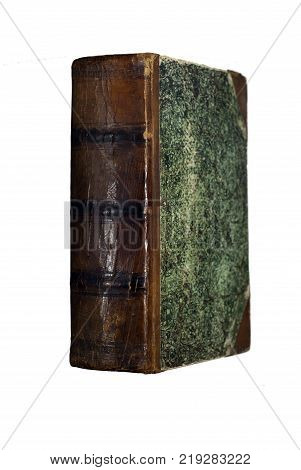 ancient books book with a cracked leather spine and green patterned binding isolated