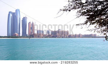 ABU DHABI, UNITED ARAB EMIRATES - APRIL 4th, 2014: Skyline view of Emirates Palace and Etihad Towers.