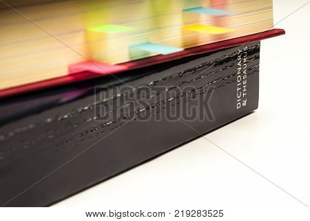 Coloured Sticky Page Markers in a text book and Dictionary