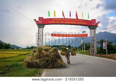 Sapa Vietnam - May 29 2016. People carry rice on rural road in Sapa Vietnam. Sapa is a frontier township and capital of Lao Cai Province in north-west Vietnam.