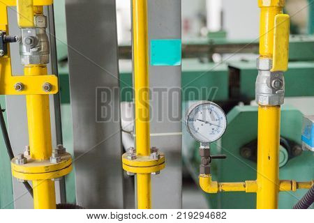close up of gauge pressure control in factory