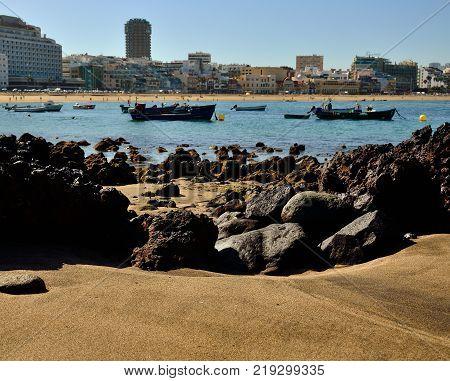 Cove of sand and rocks at low tide, Las Canteras beach, Las Palmas of Gran canaria, Spain
