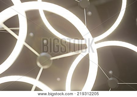 Luminous lamp in the form of a ring. Abstraction of luminous objects. Working bright ceiling lamps.