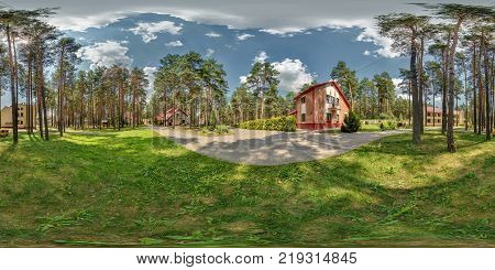 Full 360 degree seamless panorama in equirectangular spherical projection near vacation home in forest