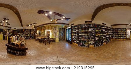 GRODNO BELARUS - JANUARY 31 2012: Interior of wine shop in ancient style full 360 seamless panorama in equirectangular equidistant spherical projection VR content