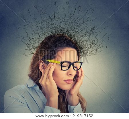 Portrait stressed young business woman having headache with worried face expression and brain melting into lines question marks. Obsessive compulsive adhd anxiety disorders concept