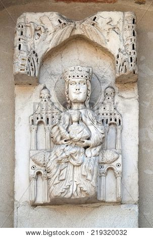 LUCCA, ITALY - JUNE 03: Enthroned Madonna, portal of Santa Maria Forisportam church in Lucca, Tuscany, Italy on June 03, 2017.