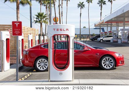 Bakersfield CA - December 18 2017: Tesla Supercharging Station at Tejon Ranch. Tesla Supercharger stations allow Tesla cars to be fast charged at the network within an hour.