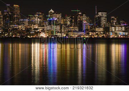 Seattle skyline at night with reflecting city lights in Lake Washington