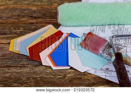 Paint brushes, paint roller on paper drawings roller brush selection of paint for the home Architectural blueprint