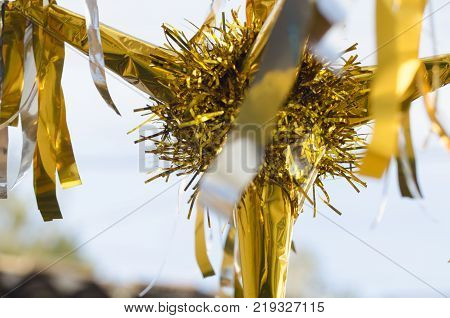 Yellow pinata as decoration for Christmas and New Year on blurry background