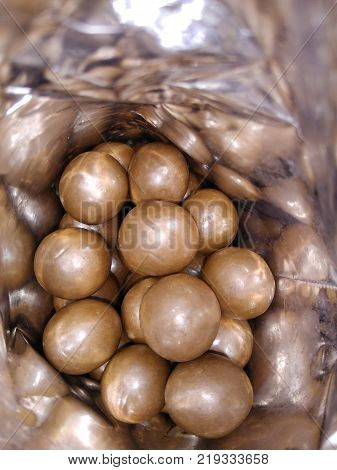 Dark and dairy chocolate balls. Chocolate drops as background texture pattern. Bon bons. Choco chocolate drops. Sweets backgrounds.