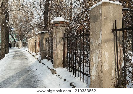 Old brick fence in old town. Old architecture. Historical architecture. Grunge landscape.