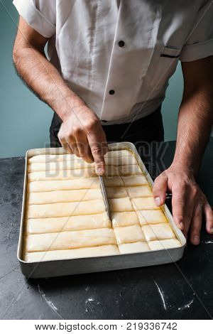 Food pastry. Baker works with dough. Chef cooks dessert at a restaurant