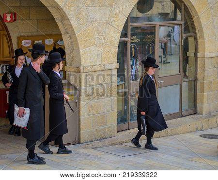 JERUSALEM ISRAEL - MAY 11 2017: Young Orthodox Jews in Hasidic Clothing Shopping in Western Wall Plaza. Jerusalem Israel - May 2017