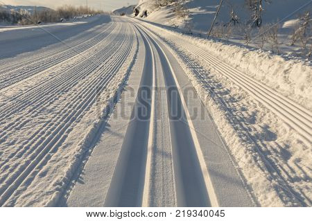 Newly groomed. Freshly prepared ski track in the winter landscape in the mountains of Brokke, Setesdal in Norway