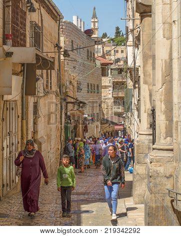 JERUSALEM ISRAEL - MAY 08 2017: Tour Groups in Old City Jerusalem Near Arab Bazaar Inside Damascus Gate. Jerusalem Israel - May 2017