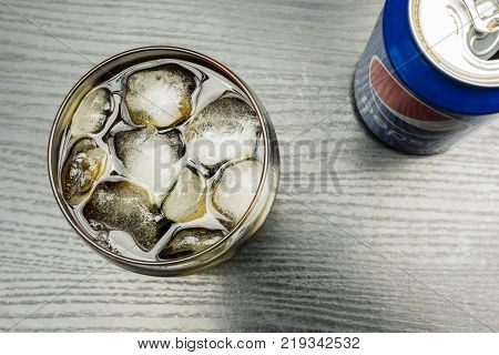 Niedomice Poland - December 22 2017: Top view of ice cubes in a glass with Pepsi.
