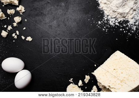 khachapuri dish food ingredients dark background. farming industry. milk products. gourmet food. negative space concept