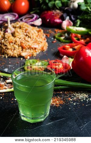 tarkhun soda traditional armenian green drink on vegetable background. Nonalcoholic refreshing beverages.