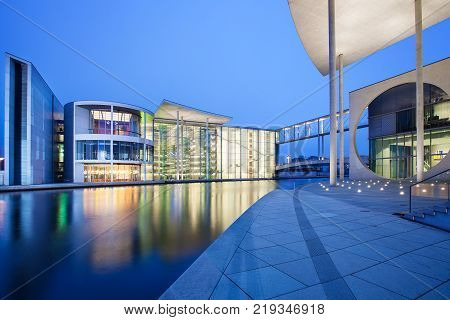Berlin, Germany - January 25, 2015: Berlin, Germany - January 25, 2015: The german chancellery building in the government district in Berlin at night. The Paul Loebe House, right, and the Reichstag, left and night.