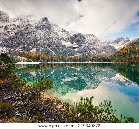 Misty morning on Braies Lake with Seekofel mount on background. Colorful autumn landscape in Italian Alps Naturpark Fanes-Sennes-Prags Dolomite Italy Europe. Artistic style post processed photo.
