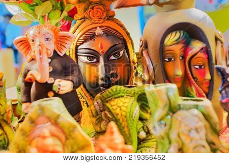 Face of tribal woman colorful dolls made of clay handicrafts on display during the Handicraft Fair in Kolkata earlier Calcutta West Bengal India. It is the biggest handicrafts fair in Asia.