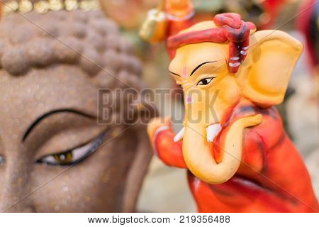 Colorful dolls made of clay Lord Ganesha handicrafts on display during the Handicraft Fair in Kolkata earlier Calcutta West Bengal India. It is the biggest handicrafts fair in Asia.