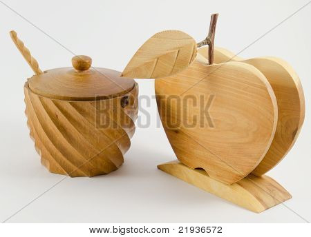 Wooden cup for spices with a small spoon and a cap and a napkin holder shaped as an apple