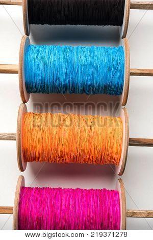 Fikri /Reel/Chakri /Spool with colourful thread or manjha or manja for Kite flying in Indian festival called Makar Sankranti which is uttarayan or uttarayana