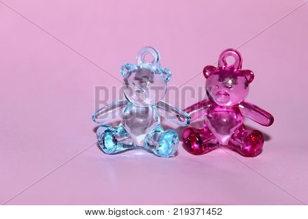 Pink Background.Newborns, Family, Childhood Concept.Toy Bears.Baby Twins Concept.Baby Twins Background with A Lot Of Copy-Space for Text.Image of a teddy bears over pink background.Toys Background.