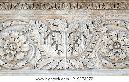 LUCCA, ITALY - JUNE 03: Stone carvings on the portal of Santa Maria Forisportam church in Lucca, Tuscany, Italy on June 03, 2017.