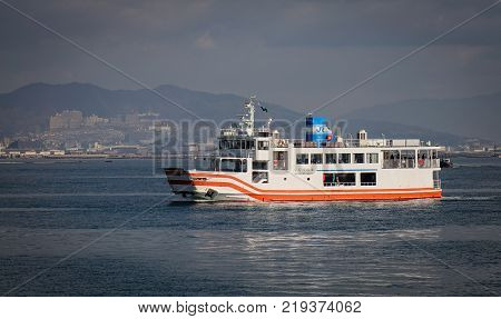 Hiroshima Japan - Dec 28 2015. A ferry carrying tourists to Miyajima Island in Hiroshima Japan. Miyajima can be reached from Hiroshima in less than an hour by train and ferry.