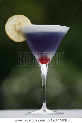 Martini drink on wooden table. Ultra violet color