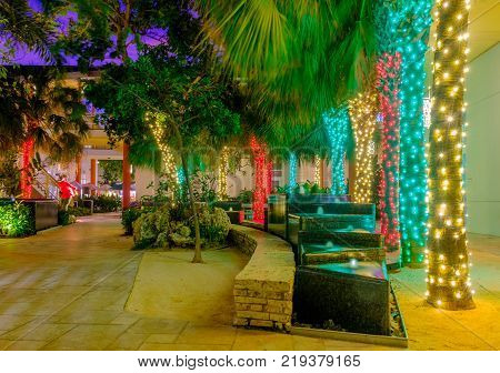 Grand Cayman, Cayman Islands, Dec 2017, water feature and Christmas lights in a pedestrian zone