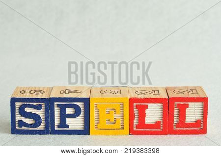 The word spell spelled with colorful blocks isolated on a white background
