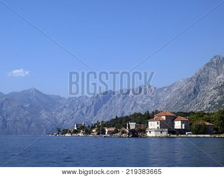 Bay of Kotor Montenegro - August 20 2007: View from boat of The Bay of Kotor known simply as Boka is the name of the winding bay of the Adriatic Sea in southwestern Montenegro.