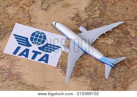 SARANSK, RUSSIA - NOVEMBER 05, 2017: International Air Transport Association logo with model of airplane on world map.