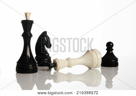 Chess game isolated on white background. Chess king is checkmated, chess game over. Black and white chess pieces business concept, leader success.