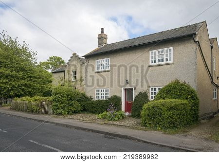 Street view of an old cottage in the pretty village of Foxton Cambridgeshire England UK