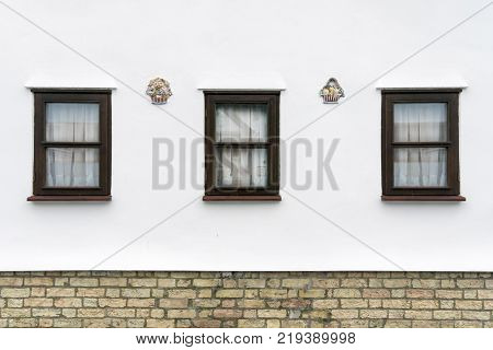 Ornate wall decorations on a house wall in the village of Foxton Cambridgeshire UK