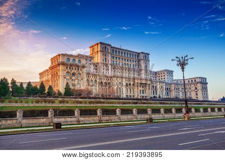 Most famous and larger building in Europe, the Parliament house of Government illuminated by sunset light in Bucharest capital, Romania