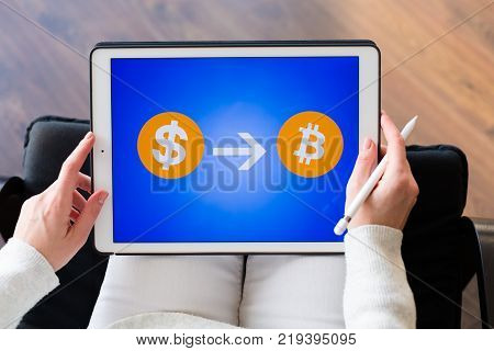Woman Holding A Tablet With Cryptocurrency Logos