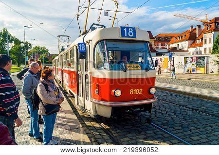PRAGUE, CZECH REPUBLIC - SEPTEMBER 29, 2013: Tram public transport on the street. Daily life in the city. Everyday life in Europe.