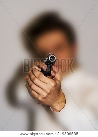 Collage. One caucasian spy criminal policeman detective man holding gun portrait silhouette in studio isolated white background