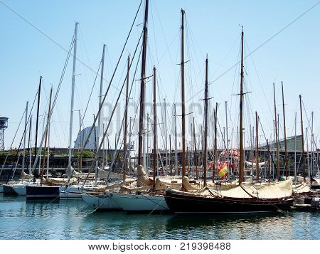 Yachts and catamarans located in the port of Barcelona, Spain. The harbor in European seacoast. Coast of the Mediterranean sea. Horizontal.