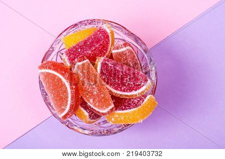 Fruit marmalade on bright colored background. Studio Photo poster