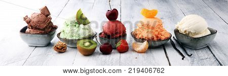 Set of ice cream scoops of different colors and flavours with berries nuts and fruits
