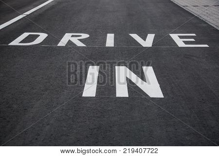 Drive In Sign on asphalt in Germany Drive Thru